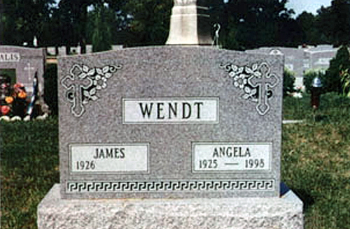 Cemetery Headstone With Greek Symbols Designed For A Couple
