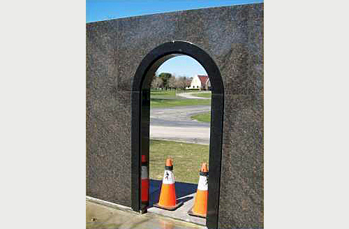 Private Mausoleum black granite door frame with semi-circle arched top.